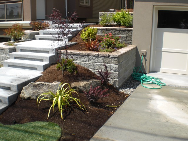 Allan block with concrete stairs and plants green s landscaping llc